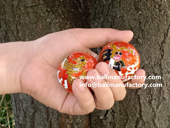 Cloisonne chiming balls with dragon and phoenix