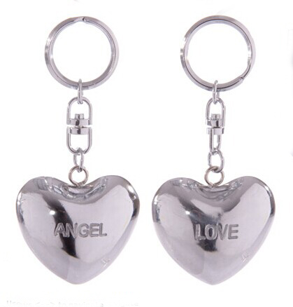 metal singing heart with keychain